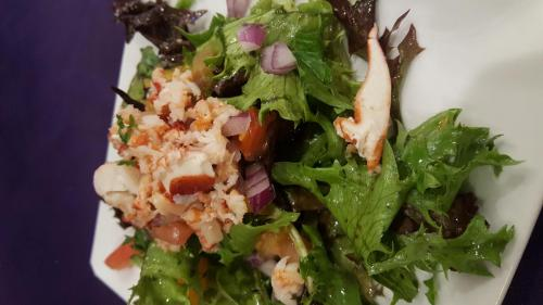 Mixed Greens, Red Onion, Heirloom Tomatoes, and Lobster with a Pesto Vinaigrette